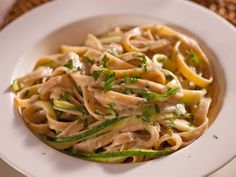 Get this all-star, easy-to-follow Food Network Fettuccini Alfredo with Zucchini Ribbons recipe from Ellie Krieger.