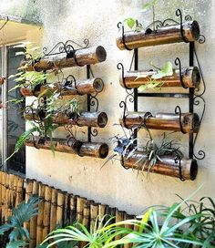 "Wall mounted wine rack and some ""distressed"" painted pvc? (or bamboo) Bamboo Planter, Bamboo Garden, Garden Planters, Garden Art, Garden Design, Vertical Planter, Balcony Gardening, Wall Planters, Vertical Gardens"