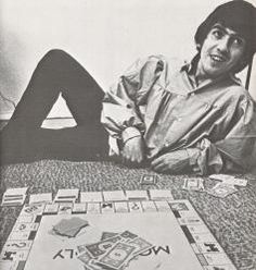 Beatle George Harrison playing Monopoly on the road in America 1964.