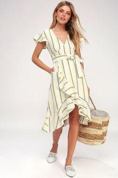 A sweet summer date calls for something as charming as the J.O.A. Coralie White and Yellow Striped Wrap Dress! Blue and yellow stripes dance across short  sleeves, a v-neck bodice, and a set in waist, (all made from airy woven cotton) atop a ruffled wrapping midi skirt. Free shipping and returns!
