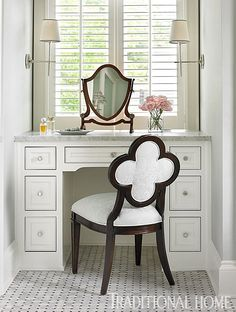 """""""A quatrefoil-back 'Alexandra' chair by Suzanne Kasler for Hickory Chair cozies up to the built-in vanity. Polished nickel 'Bryant' sconces were designed by Thomas O'Brien."""" 1928 Tudor. Interior design: Lauren DeLoach. Architect: D. Stanley Dixon. Photo: Emily Jenkins Followill. """"Colorful, Kid-Friendly Atlanta Home"""" written by Amy Elbert and produced by Lisa Mowry. Traditional Home."""
