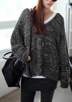 Pretty model wearing black melange front-button cardigan