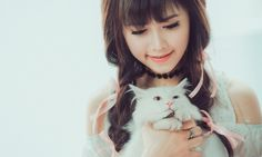 happy asian girl hugging white cat and smiling high resolution photography wallpaper