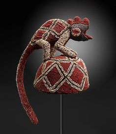 Bamileke peoples TITLE Chief's Ceremonial Hat DATE 1900–1930 MEDIUM Plant fibers, cloth, beads DIMENSIONS Overall: 17 x 12 x 12 in. (43.2 x 30.5 x 30.5 cm)  MFAH | The Museum of Fine Arts, Houston