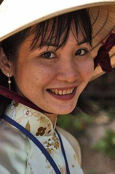 ....Rice farmer in Vietnam....Photo by Jon Hill
