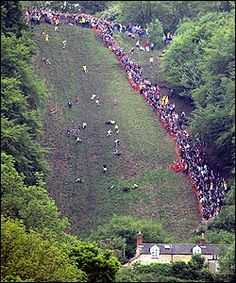 One of the oddest and iconic events that take place in Gloucestershire is cheese rolling. While it may sound like British eccentricity at its best, in fact it is steeped in legend and has a histori… Great Places, Places To See, Gloucester England, Forest Of Dean, Cheese Rolling, Thing 1, Far Away, Great Britain, United Kingdom