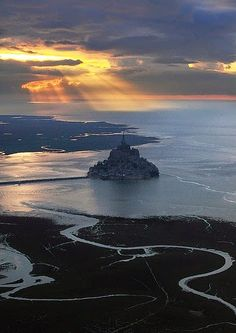 Mont Saint-Michel is an island commune in Normandy, France . It is located approximately one kilometre (just over half a mile) off the coun...