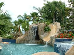 My dream backyard oasis :-) complete with waterfall, waterslide and hotub!.