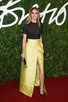 Olivia Palermo.. Emilia Wickstead Spring 2015 high-waisted yellow skirt over black lace top..