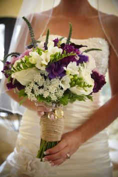 Wow this is the first bouquet I actually like. I have not really paid attention to the florals for the wedding but this caught my eye. Not too purple ya know?