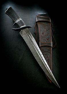 """CAS Claudio Sobral Sub Hilt fighter. 13"""" fullered damascus blade, stag handle. Another work of art."""