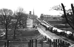 Petersburg, Virginia, the first Federal army wagon train entering the town in April of 1865. (John Reekie/LOC) #