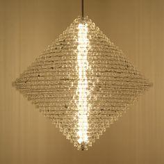 "Lighting designer stuart haygarth created this amazing chandelier from eyeglass lenses"".......london berlin ""magoo"" 2009"