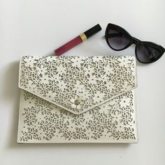 NWT Kate Spade Bradford Ct. Envelope Clutch Work Week Chic HPClassic Chic HP Quite possibly the prettiest little clutch I've seen in a long, long time! Bought one for me, one for you;  because that's what I do for my friends!   Beautiful creamy leather, laser cut in a gorgeous floral lace pattern, crafted into a modern envelope design.  One inner zipper pocket. Large enough to hold all the essentials and perfect for the season! kate spade Bags Clutches & Wristlets