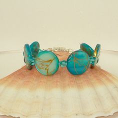 Mother of pearl and Chinese crystal bracelet in pale turquoise blue - pinned by pin4etsy.com