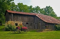 Beautiful barn with an old wagon full of flowers from Linda Hall.