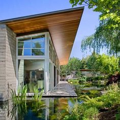sustainable-home-manmade-pond-lush-landscaping-1-pond.jpg