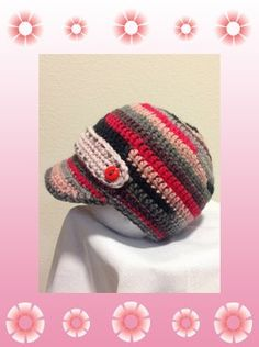 What's black, pink, and red all over?  This hand-crocheted newsboy style cap!