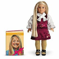 "American Girl 25th Anniversary Julie Mini Doll and Book Set by Mattel. $39.99. This special-edition mini doll is 6"" tall and arrives wearing Julie's holiday outfit. Plus, she comes with a name sticker and Happy New Year, Julie, an abridged miniature version of the book that tells her holiday story set in San Francisco in 1974"
