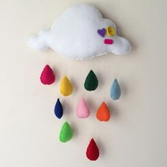 Clouds and colourful rain drops baby crib mobile!    The perfect gift for a little girl or boy! It will bring a colourful note to any nursery and