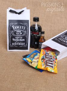Adult party favors. I don't know what that snack/candy bag is all about, but I'm feeling the Jack and Coke parting gift! ;)