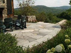 This patio has a free-form fieldstone interior field with a consistent rectangular border edge.  GREAT VIEW!