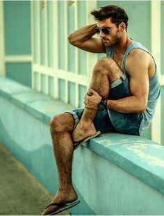 style, beard Tank, denim shorts and flip flops.