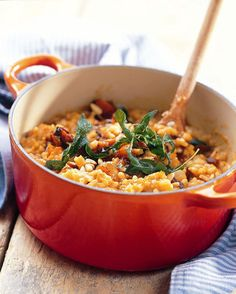 Caramelised butternut risotto with sage and pine nuts. For a vegan dish, substitute vegetable for chicken broth/stock and use grated walnuts instead of Parmesan cheese.