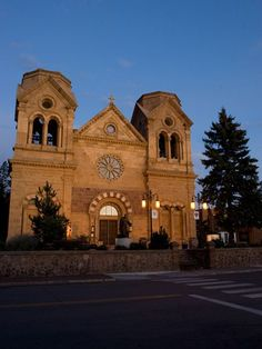 Photograph by Krista Rossow  Located a block away from the Plaza, the Romanesque-style Cathedral Basilica of St. Francis of Assisi was built between 1869 and 1886 by Archbishop Jean-Baptiste Lamy, the first Archbishop of Santa Fe.