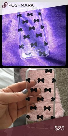 """Kate Spade New York iPhone 5 phone case cover. Kate Spade iPhone phone cover for iPhone 5, in excellent condition. Clear with black bow ties and Gold """"Kate Spade"""" emblem. Package ships from Atlanta kate spade Accessories Phone Cases"""