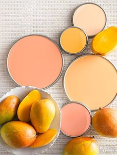 """Whether they're energetic orange or subtle pink, mangoes offer plenty of color inspiration and are perfect for adding warmth and energy to a space. """"These shades bring such warmth to a space, and it can be fun to just saturate the room with an orange glow. Layer in yellows and golds, copper and brass, and rich dark woods,"""" color and pattern expert Khristian A. Howell says."""