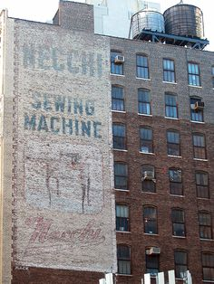 Necchi Sewing Machine, 164 W. 25th St. near 7th Ave. (2002) Necchi Sewing Machine opened its 1st NY sales office in 1948. They moved into this bldg on 25th St. in '49 & remained here until ~ 1966/67. Sign painted by Harry Middleton of Mack Sign Co. in '51. (More on Mack Sign Co. see Mack page.) Original layout for the job, dated 6/18/51, still exists. Necchi is an Italian sewing machine manufactured in Pavia, Italia since the 1930s.