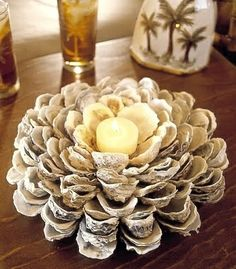 Beach Cottage Decor – Oyster shell candle holder. Step by step instructions are posted on Waterside Cottages. Materials: Several dozen cleaned oyster shells Hot glue gun Tea light candle @ Home DIY Remodeling