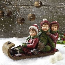 Kids in Sled Figurine