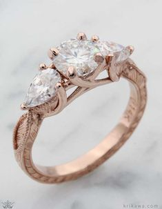 Customize any of our ring designs in the metal and stones you love most! Like this Vintage Three Stone Crossover Engagement Ring in 14k rose gold.