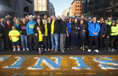 More than 200 people affected by the Bostom Marathon bombing returned to the finish line of the Boston Marathon for a group portrait.