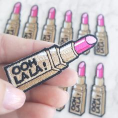 "Always have your lipstick on with this super glam patch! Hot pink lipstick in glam gold-tone tube emblazoned with ""Ooh La La"". Patch by Wildflower + Cute Patches, Pin And Patches, Iron On Patches, Gifts For Makeup Lovers, Hot Pink Lipsticks, Embroidery Patches, Embroidered Patch, Fabric Patch, Gifts"