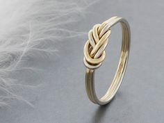 alternative engagement ring, 14k solid gold climbing knot ring, tied and dressed double figure 8 knot by TDNCreations on Etsy