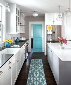 Up a Snug 1941 Cottage A pocket door, punched up with aqua paint, closes off this laundry room.A pocket door, punched up with aqua paint, closes off this laundry room. Bright Kitchen Colors, Aqua Kitchen, Bright Kitchens, Kitchen Paint, Turquoise Kitchen Decor, Kitchen Black, Room Kitchen, Turquoise Kitchen Cabinets, Teal Kitchen Walls