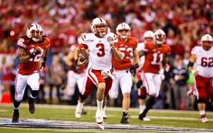 Nebraska quarterback Taylor Martinez breaks away for a touchdown against Wisconsin in the first quarter of the Big Ten championship game.