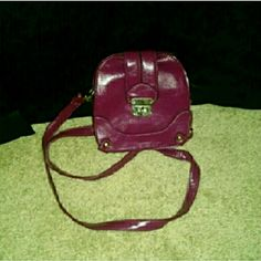 Magenta Cross-Body Structured Purse This cross-body structured purse is a beautiful magenta color that will compliment any outfit! The outside dimensions are 6.25x6.5x2.  The inside dimensions are 5x5x1. This purse was only used one time and is in excellent condition! street level  Bags Crossbody Bags