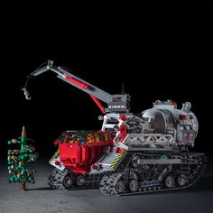Time for Santa Claus to load the Christmas tree on his Prinoth Arctic Crawler do., for Santa Claus to load the Christmas tree on his Prinoth Arctic Crawler done with lego bricks! Cool Lego, Cool Toys, Awesome Lego, Lego Crane, Lego Gears, Technique Lego, Lego Truck, Amazing Lego Creations, Lego Spaceship