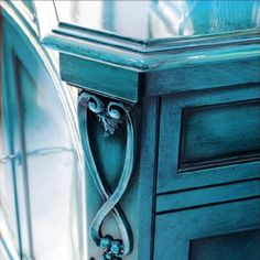 Create a dark, antiqued effect in the cracks and corners of your piece of furniture with paint and glaze.