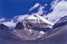Mt. Kailash, Tibet~A great mass of black rock soaring to over 22,000 feet, Mt. Kailash has the unique distinction of being the world's most venerated holy place at the same time that it is the least visited. The supremely sacred site of four religions and billions of people, Kailash is seen by no more than a few thousand pilgrims each year.