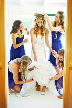Bridesmaids helping the bride finish getting ready! | Priscila Valentina Photography | Theknot.com