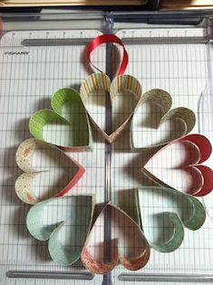 Might make this with cookie cutters instead of paper for a valentine wreath on my door...