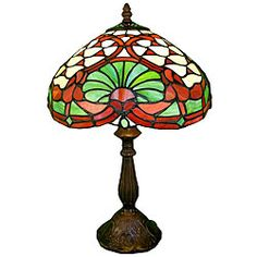 @Overstock - This handcrafted stained glass Tiffany-style table lamp is a colorful decorative piece that will enhance any room. The light from the lamp will glow radiantly through the colored glass on the lampshade. Color shades include green, orange, and red.http://www.overstock.com/Home-Garden/Tiffany-style-Louis-Table-Lamp/4702826/product.html?CID=214117 $78.99