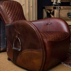 Timothy Oulton's saddle chairs are the best looking leather armchairs around. Without a doubt my favourite accent chair. Perfect for a nature-inspired living room. Astounding!