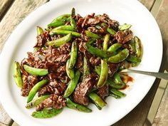 Intensely beefy and buttery skirt steak is the star of this quick stir-fry, featuring sweet snap peas tossed in oyster sauce.\n