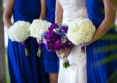 Love the white bridesmaid flowers and the colorful bride. Purple flowers, blue dresses. This is exactly it.